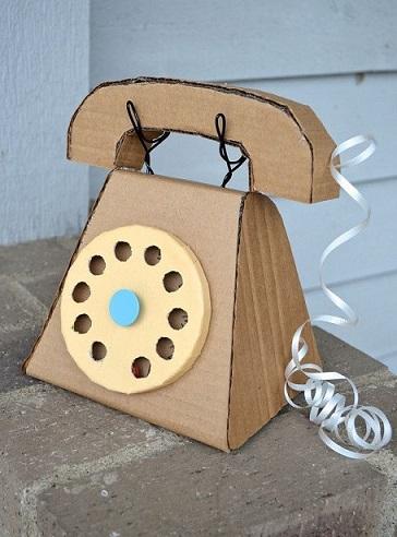 Brinquedos feitos com caixas de papel o macetes de m e for Telefono oficina caixa